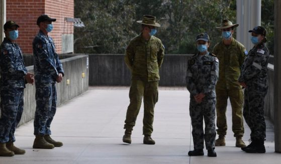 Members of the Australian Defence Force from the Air Force, Army and Navy, all of whom will serve as support to the NSW Police Service, attend a media conference at Sydney Police Centre in Sydney on Monday.