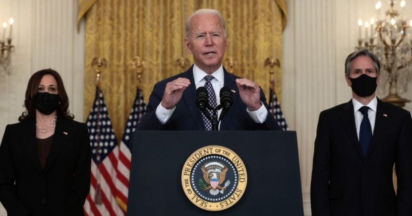 President Joe Biden delivers remarks on the U.S. military's ongoing evacuation efforts in Afghanistan, while flanked by Vice President Kamala Harris, left, and Secretary of State Antony Blinken, right, in the East Room of the White House on Friday in Washington, D.C.
