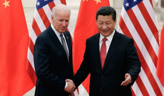 Chinese President Xi Jinping, right, shakes hands with then-U.S. Vice President Joe Biden inside the Great Hall of the People on Dec. 4, 2013, in Beijing, China.