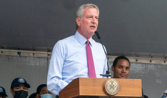 Democratic New York City Mayor Bill DeBlasio presents a proclamation at the 46thPrecinctsNationalNight Out on Tuesday in the Bronx borough of New York City.