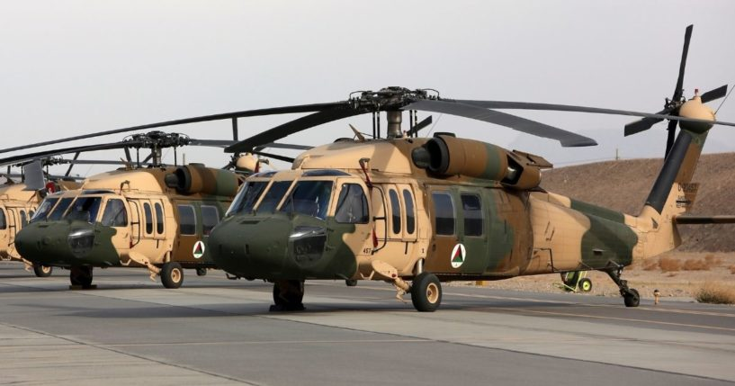 In this 2018 photo, UH-60 Black Hawk helicopters are parked at Kandahar Air Field in Afghanistan.