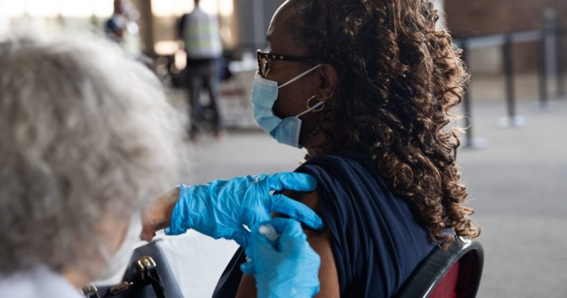 Takalya Faulkner receives her booster dose of the Pfizer-BioNTech coronavirus vaccine during an Oakland County Health Department vaccination clinic at the Southfield Pavilion on Aug. 24, 2021, in Southfield, Michigan.