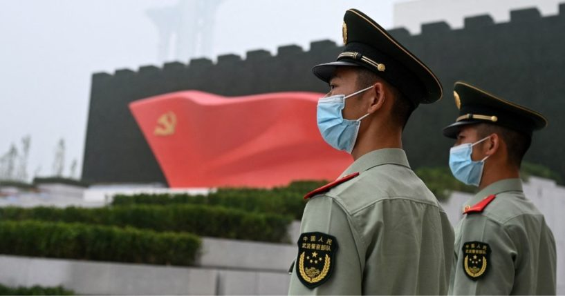 Paramilitary police stand outside the Museum of the Communist Party of China in Beijing on June 25, 2021.