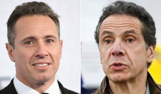 This combination photo shows CNN news anchor Chris Cuomo, left, at the WarnerMedia Upfront in New York on May 15, 2019, and Democratic New York Gov. Andrew Cuomo speaking during a news conference in New York on March 23, 2020.