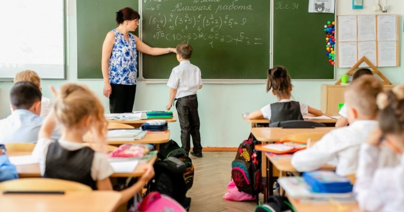 Children are pictured in an elementary school classroom in the stock image above.