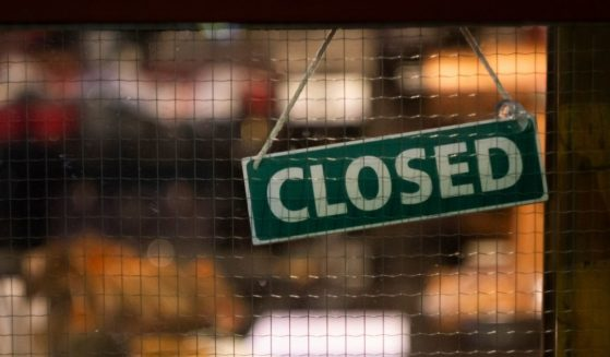 """This stock image portrays a """"Closed"""" sign on a store window. Quebec's Health Minister Christian Dubé announced that beginning Sept. 1, the province will mandate proof of vaccination in order for customers to patronize designated non-essential businesses."""