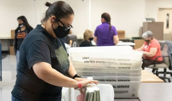 A Maricopa County Elections Department staff member counts ballots on Oct. 31, 2020 in Phoenix, Arizona.