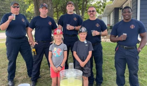 Firefighters visit a lemonade stand in Iowa after a stranger stole the tip jar from the kids running it.