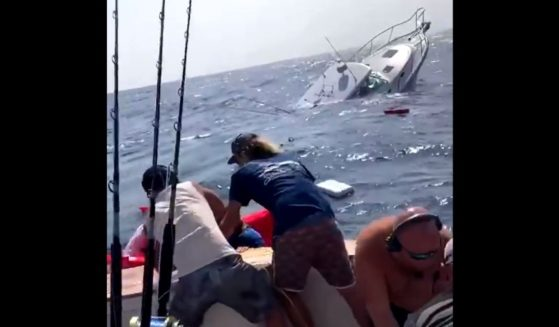 The crew of the Fishbone helps rescue those on the Knot Stressin after it took on water and started sinking during the White Marlin Open in Ocean City, Maryland.