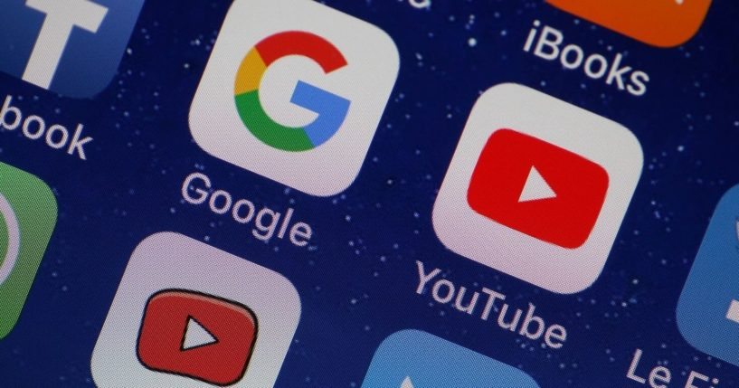 The YouTube and Google apps are displayed on an Apple iPhone