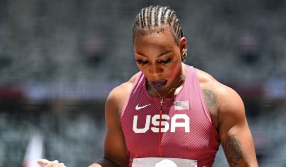 Gwen Berry competes in the women's hammer throw qualification during the Tokyo Olympic Games at the Olympic Stadium in Tokyo on Sunday.