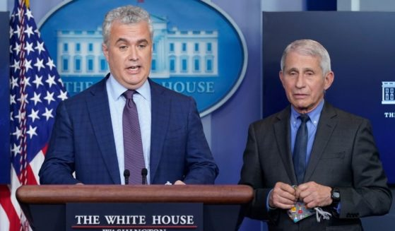 White House COVID-19 Response Coordinator Jeff Zients, left, speaks alongside Dr. Anthony Fauci, director of the National Institute of Allergy and Infectious Diseases, during a media briefing at the White House on April 13, 2021, in Washington, D.C.