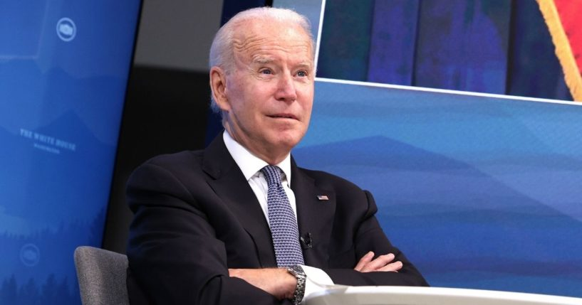 President Joe Biden listens during a meeting in the Eisenhower Executive Office Building in Washington on Friday.