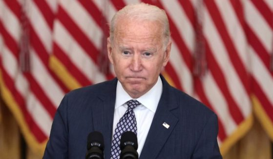 President Joe Biden gestures as delivers remarks on the U.S. military's ongoing evacuation efforts in Afghanistan from the East Room of the White House on Friday.