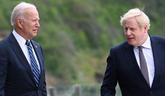 U.S. President Joe Biden, left, speaks with U.K. Prime Minister Boris Johnson outside Carbis Bay Hotel on June 10, 2021, near St Ives, England.