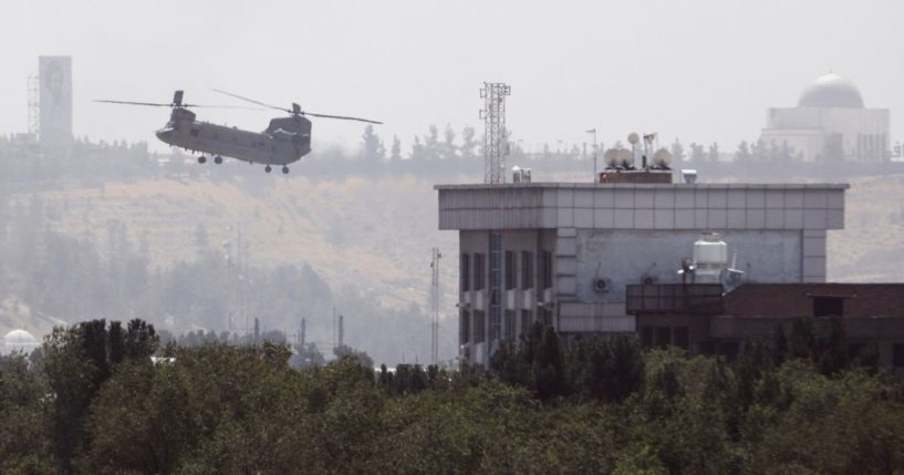 A Chinook helicopter flies near the U.S. Embassy in Kabul, Afghanistan, on Sunday.