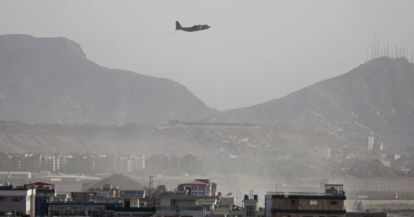 A military aircraft takes off from the military airport in Kabul, Afghanistan, on Friday.