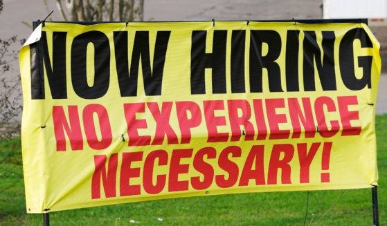 A roadside banner beckons potential employees outside Channel Control Merchants LLC in Hattiesburg, Mississippi, on March 27.