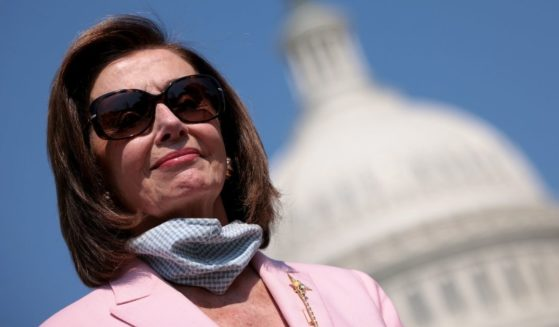 Speaker of the House Nancy Pelosi waits to speak during a news conference on Wednesday in Washington, D.C.