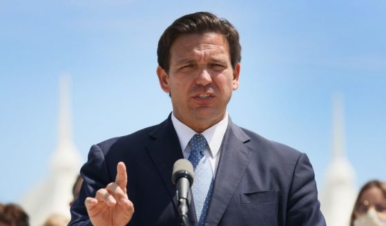 Florida Gov. Ron DeSantis speaks to the media about the cruise industry during a news conference on April 8, 2021, in Miami.