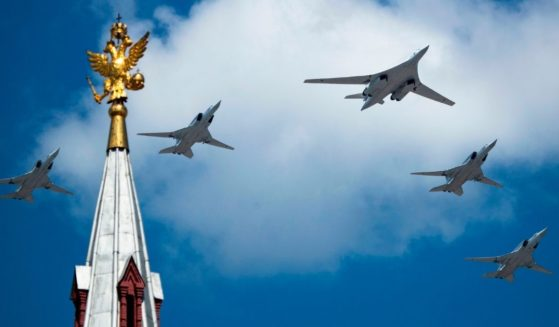 A Tupolev Tu-160 and Tu-22M3 military aircraft fly over Red Square during a military parade in Moscow on June 24, 2020.