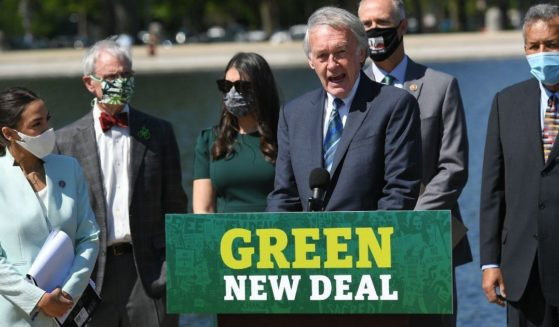 Massachusetts Democratic Sen. Ed Markey, center, and New York Democratic Rep. Alexandria Ocasio-Cortez, left, introduce the Green New Deal on the step of the U.S. Capitol on April 20, 2021.