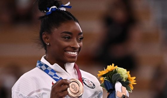 U.S. gymnast Simone Biles poses with her bronze medal during the podium ceremony of the balance beam competition of the Tokyo Olympic Games at the Ariake Gymnastics Centre on Tuesday.