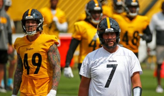 Quarterback Ben Roethlisberger (No. 7) and other members of the Pittsburgh Steelers take the field during training camp at Heinz Field on Thursday.