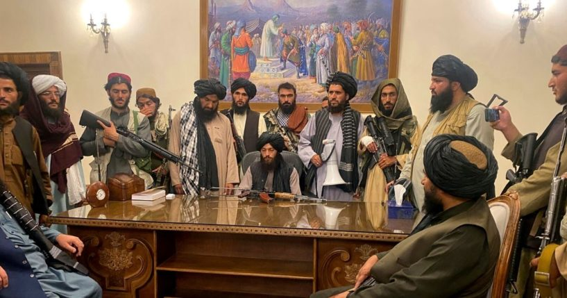 Taliban fighters take control of the Afghan presidential palace in Kabul on Sunday.