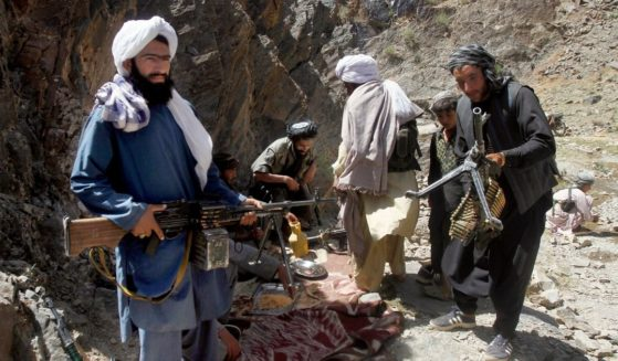 In this May 27, 2016, file, photo, members of a breakaway faction of the Taliban fighters prepare to guard a gathering in the Shindand district of Herat province, Afghanistan.