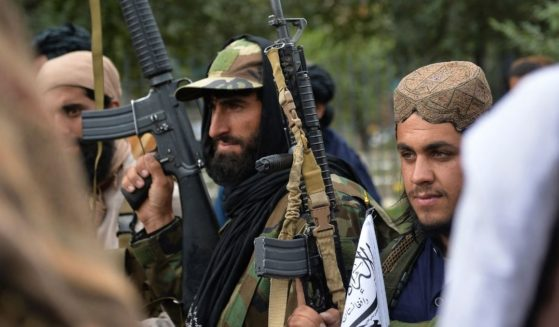 Taliban fighters gather along a street during a rally in Kabul, Afghanistan, on Tuesday.