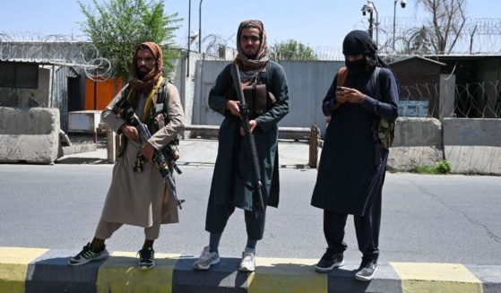 Taliban fighters stand guard along a street in Kabul on Monday after a stunningly swift end to Afghanistan's 20-year war, as thousands of people mobbed the city's airport trying to flee the group's feared hardline brand of Islamist rule.