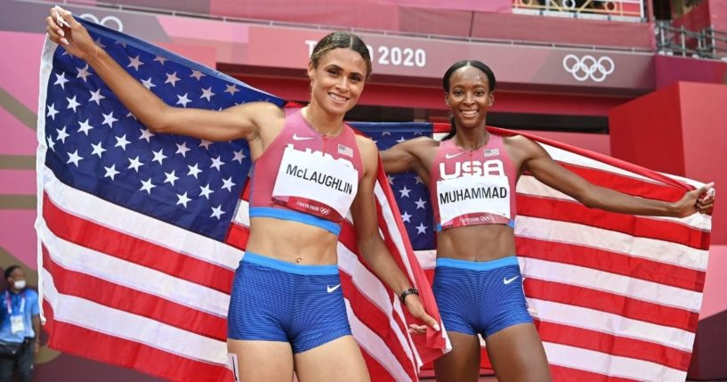 First-placed U.S.A.'s Sydney Mclaughlin, left, and second-placed U.S.A.'s Dalilah Muhammad celebrate after competing in the women's 400m hurdles final during the Tokyo 2020 Olympic Games at the Olympic Stadium in Tokyo on Aug. 4, 2021.