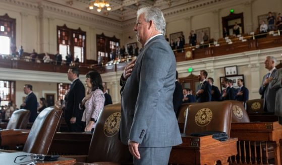 Texas state representatives recite the Pledge of Allegiance in the House chamber at the start of the 87th Legislature's special session at the state Capitol on July 8, 2021, in Austin, Texas.
