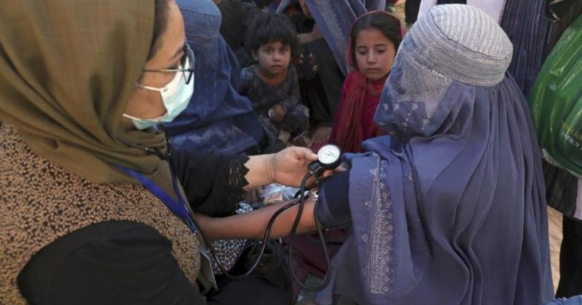 A woman is seen having her blood pressure taken at a public park in Kabul, Afghanistan, on Aug. 10, 2021.