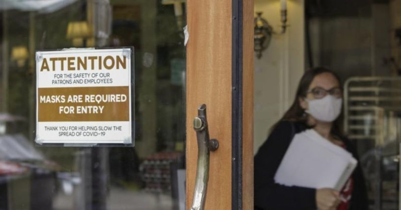 A photo taken on May 21, 2021, shows a sign telling people to wear masks at a bakery in Lake Oswego, Oregon.