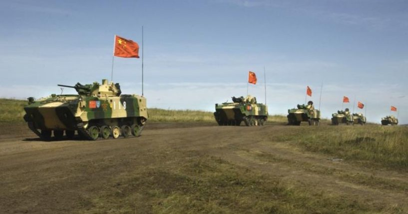 A photo taken on Aug. 13, 2007, shows a convoy of Chinese APCs performing military exercises in the Chelyabinsk region in Russia's Ural Mountains.