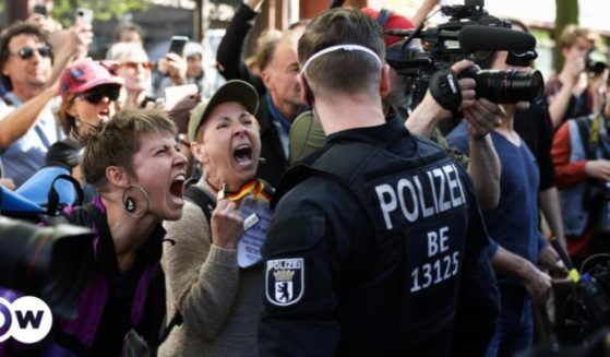 Anti-lockdown protesters scream at police in Berlin on the weekend of July 31, 2021