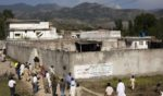 On May 3, 2011, people gather outside Osama bin Laden's compound, where he was killed the previous day during a raid by U.S. special forces in Abbottabad, Pakistan.