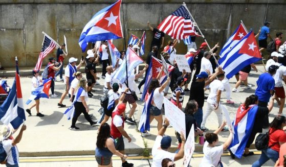 Protesters march on the Cuban Embassy in Washington on July26 to show support for demonstrations in Cuba that have rocked the island's communist regime.