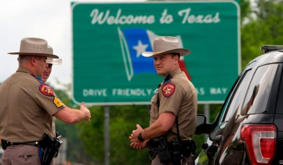 Texas state troopers, pictured in a file photo from March 2020 on the Louisiana border.