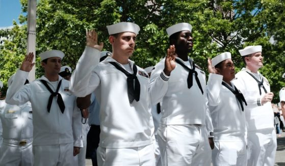 Navy personnel participate in a re-enlistment and promotion ceremony in May 2019 in New York City.