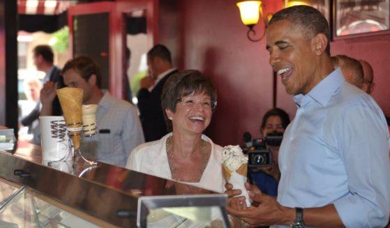 Then-President Barack Obama shares a laugh with longtime adviser Valerie Jarrett in a June 2014 file photo.
