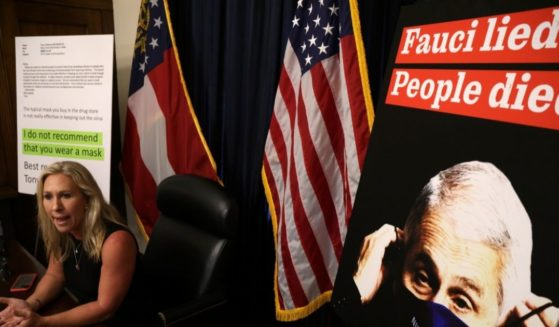 U.S. Rep. Marjorie Taylor Greene, a Republican from Georgia, speaks during a news conference in her office in Washington, D.C., on July 20, 2021, with a poster of Dr. Anthony Fauci nearby. Critics of Fauci, the director of the National Institute of Allergy and Infectious Diseases, say he has given inconsistent information to the public about the coronavirus.