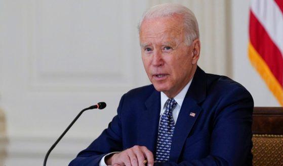 President Joe Biden speaks in the State Dining Room of the White House on Tuesday.