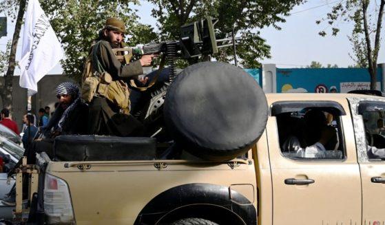 Taliban fighters patrol Kabul on Thursday.