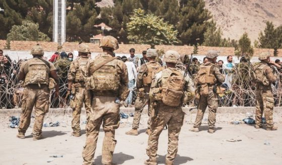 A handout photo from the United States Marine Corps shows Marines and American soldiers guarding Hamid Karzai International Airport in Kabul, Afghanistan, on Aug. 19. On Wednesday evening, The U.S. Embassy warned Americans in Kabul not to go to the airport.