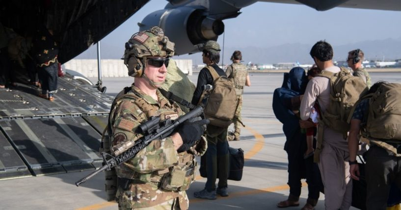 U.S. Air Force loadmasters and pilots assigned to the 816th Expeditionary Airlift Squadron, load passengers aboard a U.S. Air Force C-17 Globemaster III at Hamid Karzai International Airport last week.