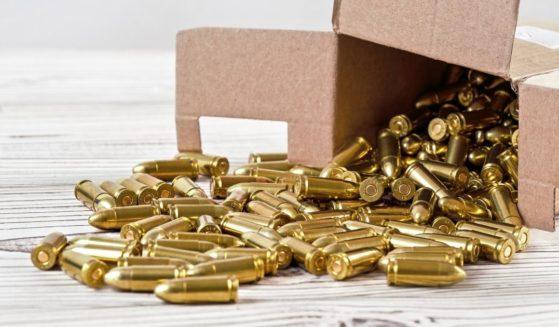 A box of ammunition spilling open.