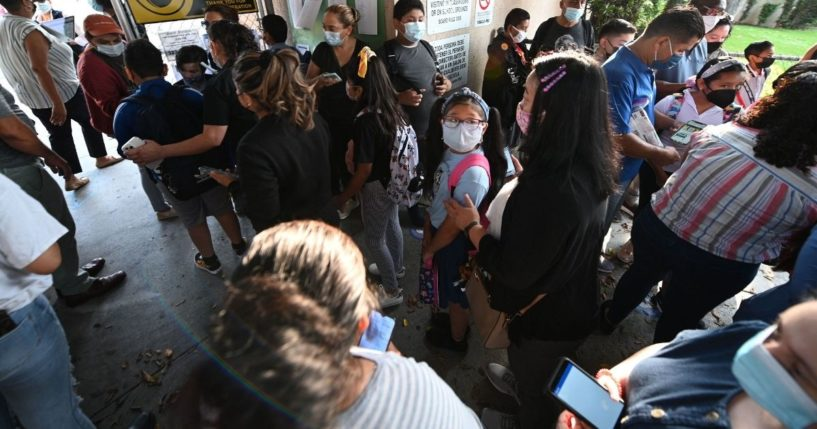 Students and parents at Grant Elementary School in Los Angeles kick off the school year complying with rules requiring masks inside school buildings in an Aug. 16 photo.